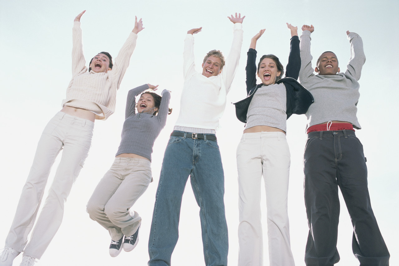 Teenagers Jumping --- Image by © Royalty-Free/Corbis